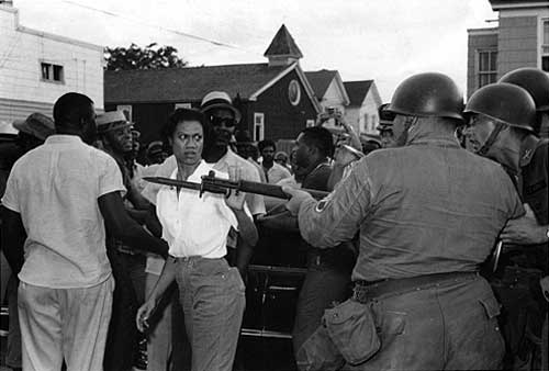 Gloria Richardson facing off the National Guard, Cambridge, Maryland, May 1964. Photo by Fred Ward