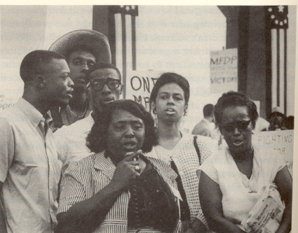 Fannie Lou Hamer and Ella Baker address participants at a rally for the MFDP to be seated at the 1964 DNC. (AP Photo)