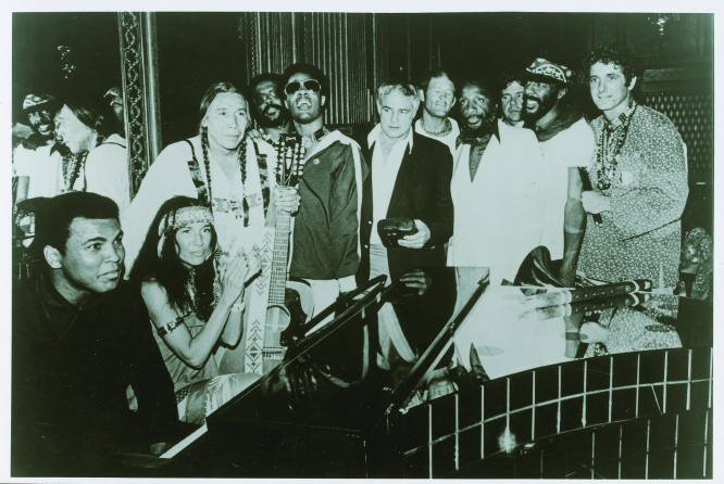 Photo: David Amram The Longest Walk, 1978. Muhammad Ali, Buffy Sainte-Marie, Floyd Red Crow Westerman, Harold Smith, Stevie Wonder, Marlon Brando, Max Gail, Dick Gregory, Richie Havens and David Amram at the concert at the end of the Longest Walk, a 3,600-mile protest march from San Francisco to Washington, D.C., in the name of the Native rights.